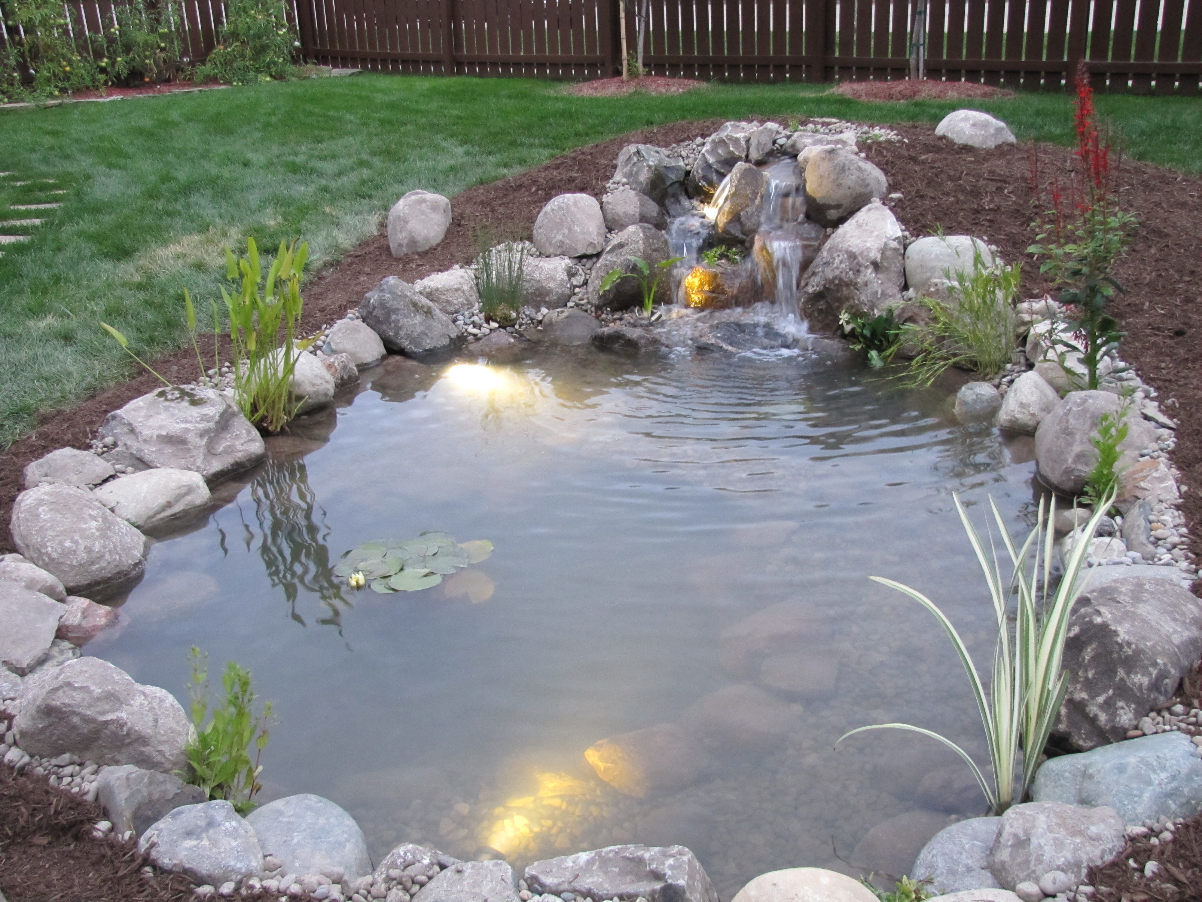 Pondering waters l l c video image gallery proview for Yard water ponds