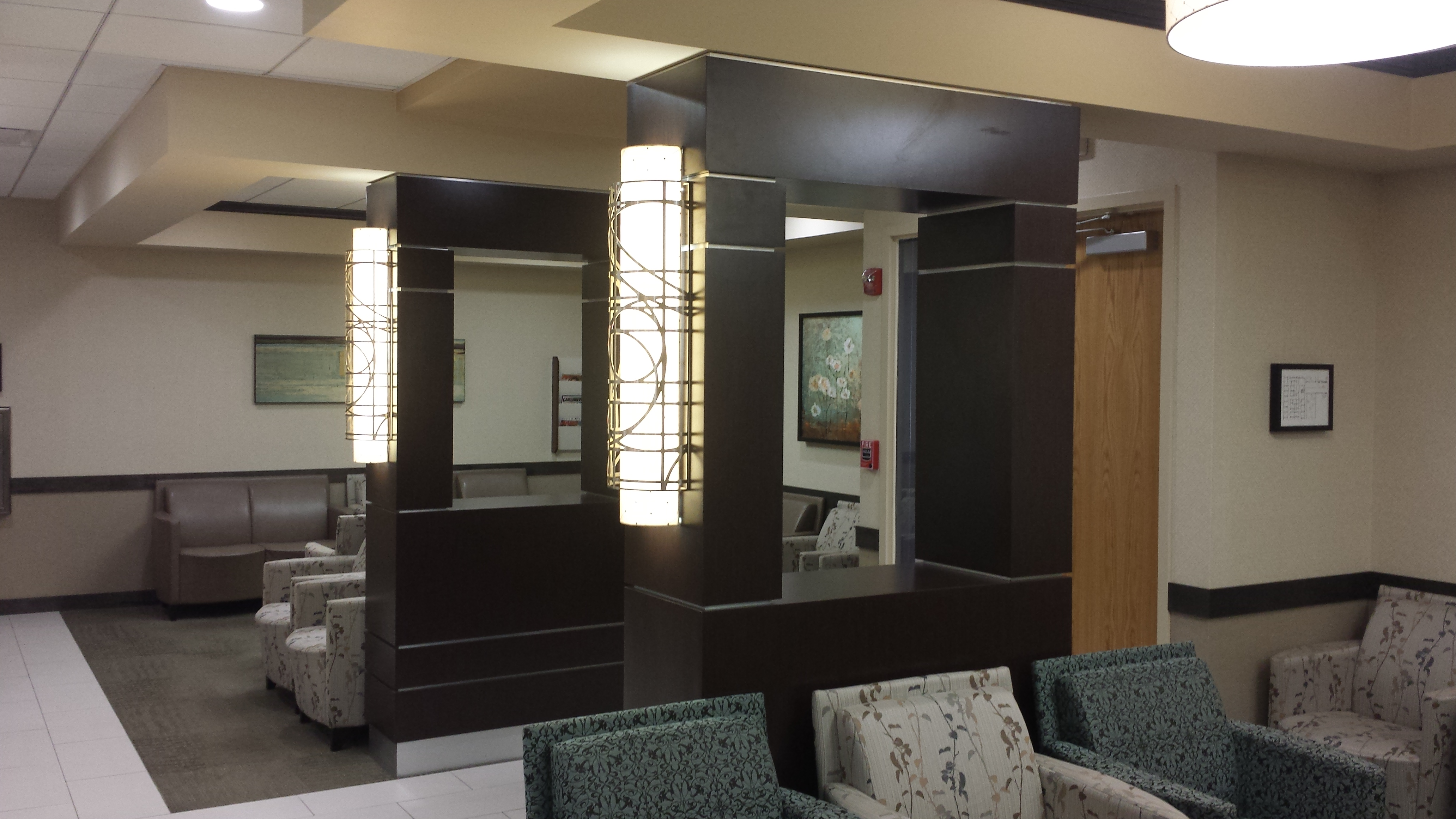 Columns leading to Reception Desk at one of LIJ Health Suites