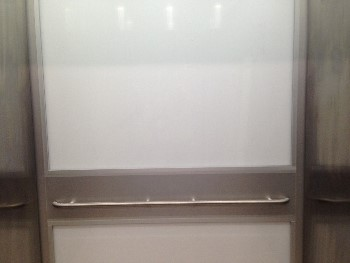 Elevator Aluminum Back Wall (Before) - SteelPro Specialties, Inc.