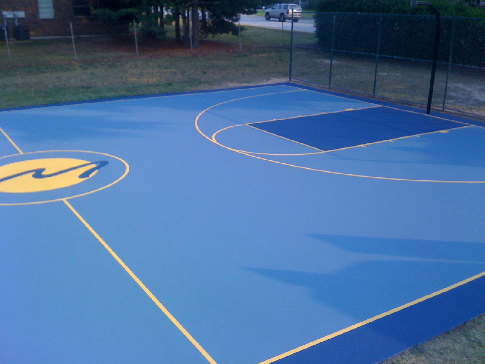 Ace surfaces north america inc video image gallery for Custom basketball court cost