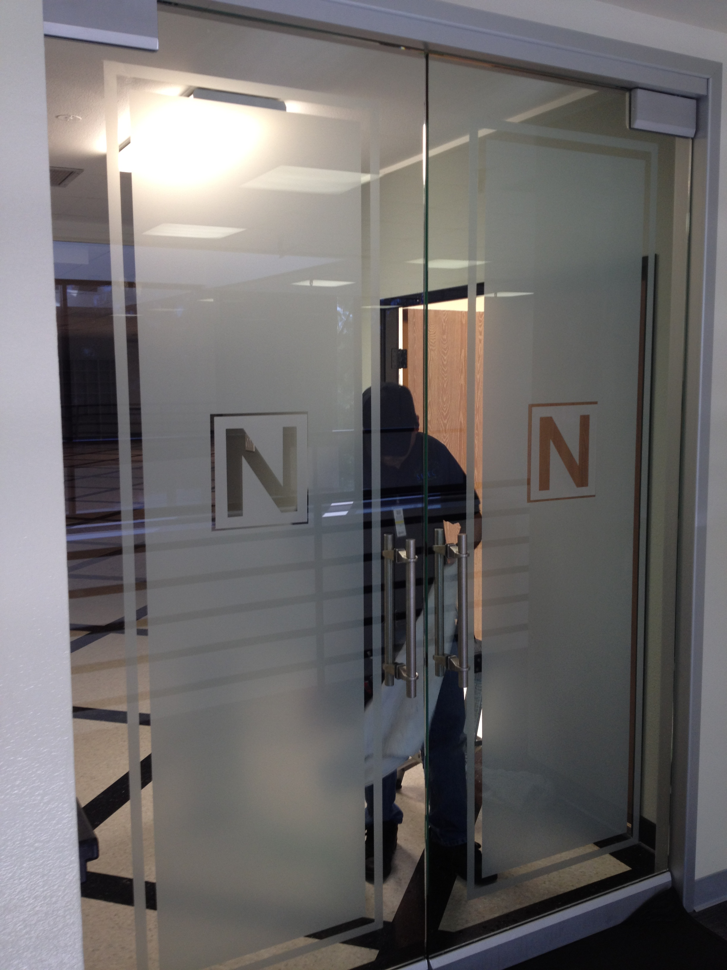 Custom Frost Doors With Logos - Select Window Films, Inc.