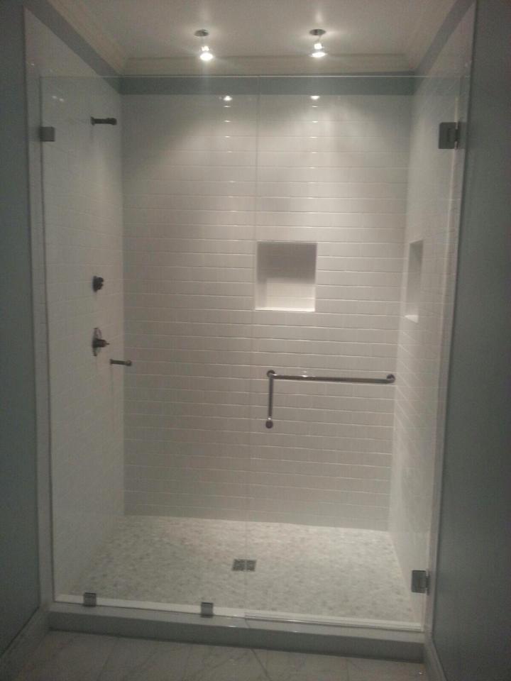 Custom frameless door and inline panel with towel bar handle combo