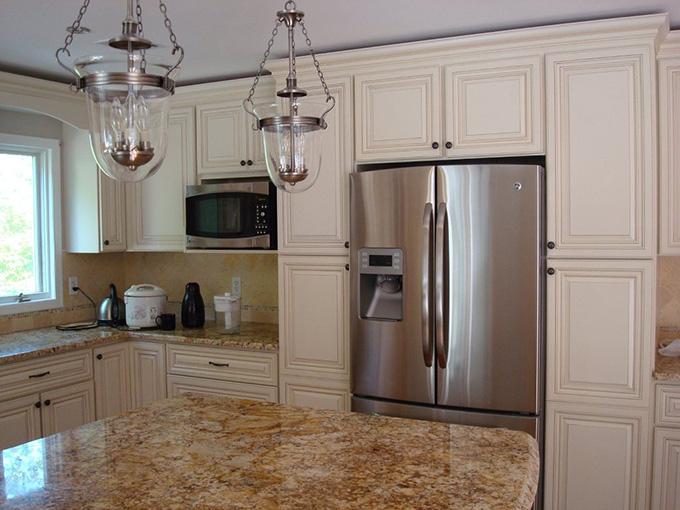 In stock Maple Cabinet in Wheaton style in a Cream brown glaze finish