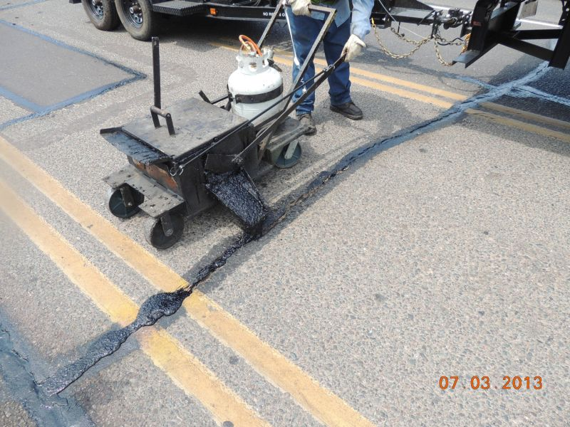 Wide Crack Repair - Pavement Scopers A Division of Bennetts and Son Inc.