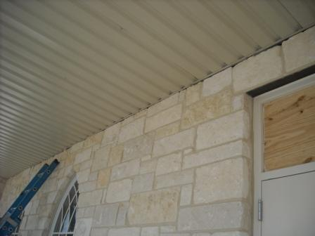 Metal soffit is rough against masonry