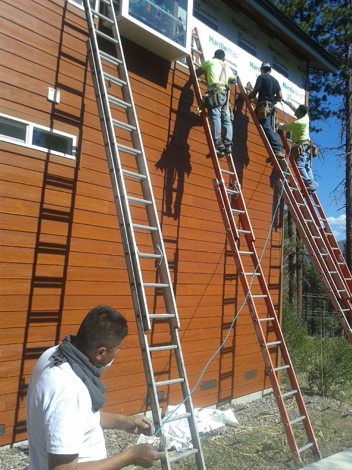 Installers Repair Damaged Siding  - Greenlight Building Services, Inc.