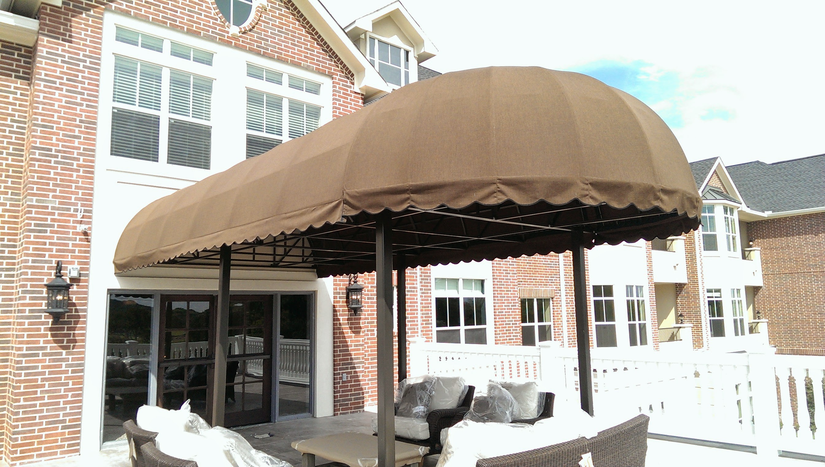 Universal Awnings Post Supported Awning Over Patio Area