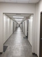 Hallway After retrofit LED edge panels - Quick Lighting Solutions