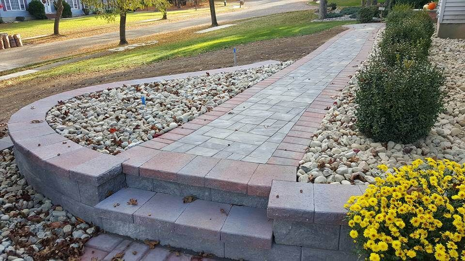 Walkway, steps, walls, river rock/planting beds