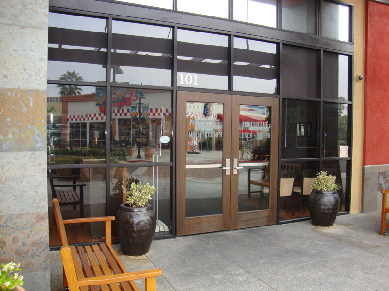 Commercial Storefront Doors and Windows - Orange Mirror and Glass