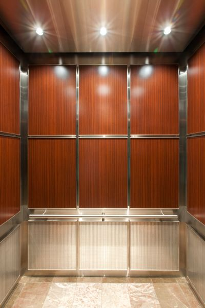 Elevator Cab With Wood Grain Plastic Laminate U0026 Architectural Stainelss  Steel Mesh Panels