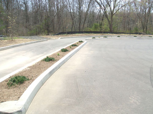 concrete curb crafters drive thru curbing on finished asphalt