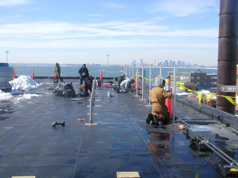 Deer Island Rubber Roof and Solar Panel Stanchion Installation - Corolla Roofing