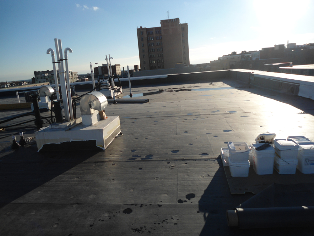 EPDM Roof Completed - CDA Roofing & House Raising LLC