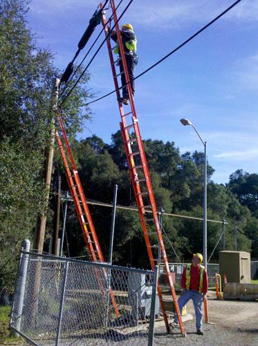 1-mile of fiber optic cable on utility poles! - Polytron Corporation