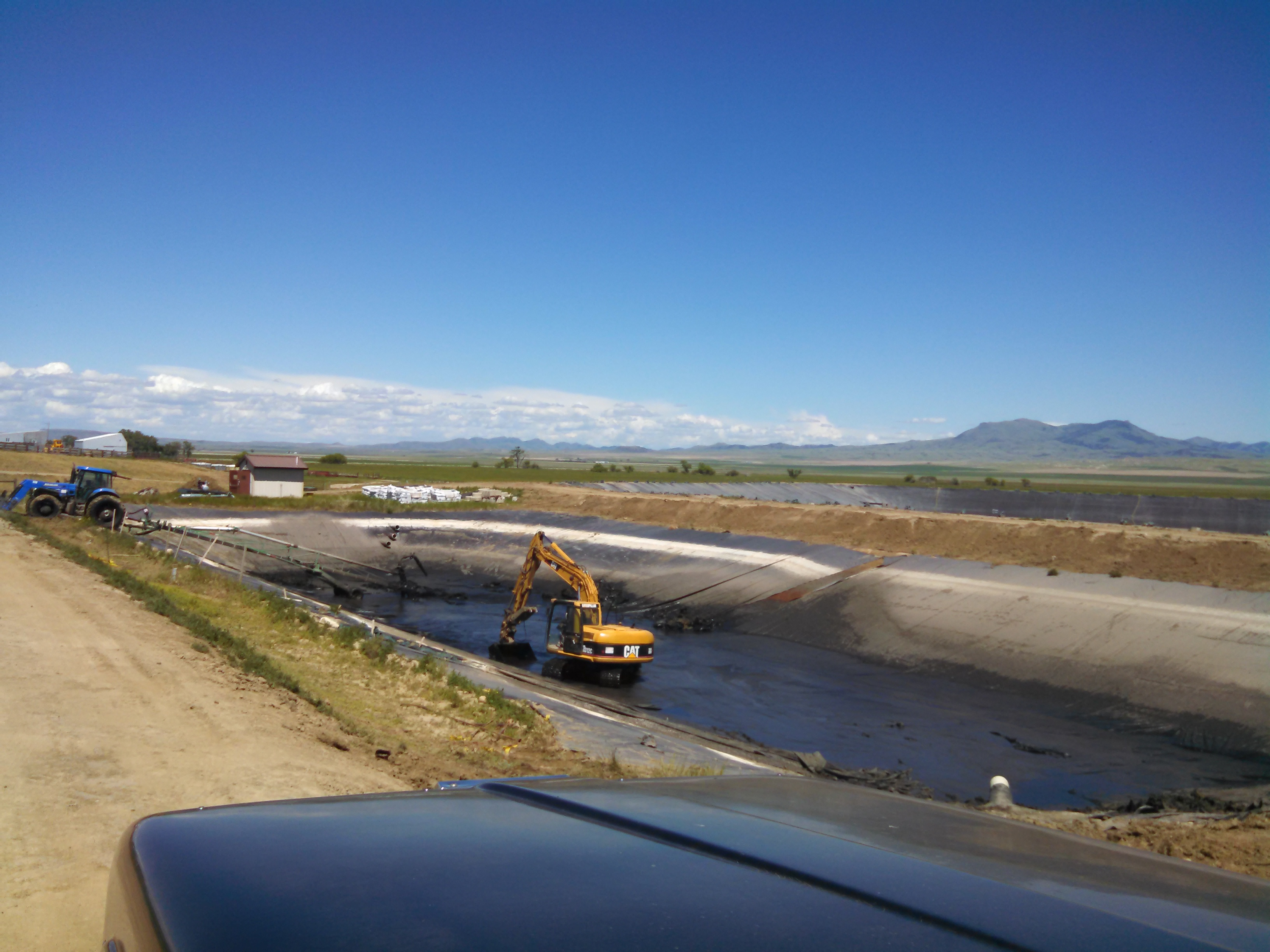 Big Sandy - Cleaning sludge out of old sewage lagoon