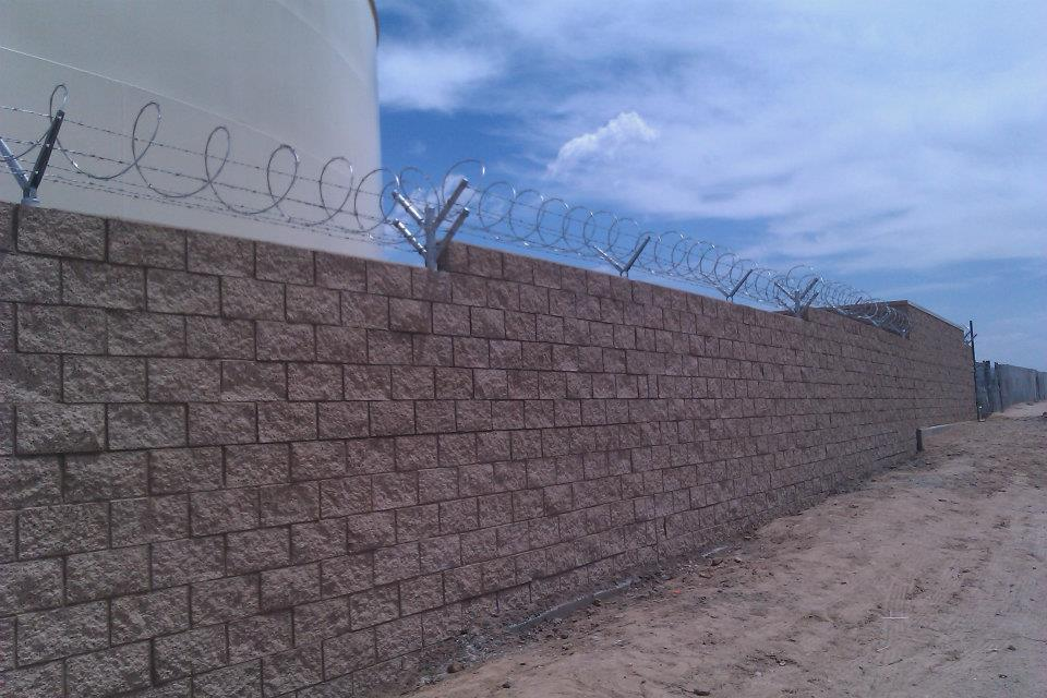Moore Fence Co. - Security Razor wire on wall Image | ProView